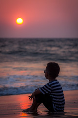 Young contemplation (Aiel) Tags: goa calangute beach sunset india boy kid reflections waves