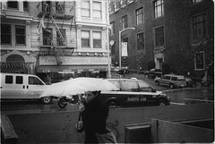 (AlanDejecacion) Tags: rain winterstorm umbrella film sanfrancisco california usa rainset ilforddelta3200 leicam6 summicron3520