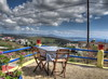 20160506-152525LCAnd2morePainterly (Luc Coekaerts from Tessenderlo) Tags: cc0 creativecommons hdr 20160506152525lcand2morepainterly hdrpainterly red blue streetview cafe terrasse object table chair flowerpot bloempot landscape sea yellow multicolored colorful kleurrijk public nobody coeluc vak201605rodos vak rodos greece rhodes grc kritinia monólithos