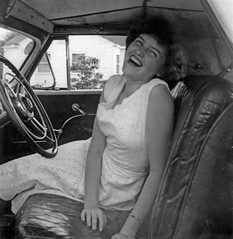 Mom in a Convertible, May, 1953 (Patrick Q) Tags: old family friends summer blackandwhite bw sun white black classic 1948 girl smile car youth vintage mississippi poster mom fun happy blackwhite interestingness familyhistory mine dress ride friendship antique deluxe joy young mother plymouth convertible mama retro highschool special explore story 1950s teenager summertime 50s passenger 53 coupe carefree sundress 1947 1953 oldfamilyphotos 1946 eyelet centralhighschool 50sstyle anecdote bestcomments interestingness429 i500 mar42006 explore429 memoryofadress