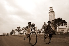 ligid (Farl) Tags: travel lighthouse game boys sepia kids fun play philippines hill running tires nostalgia cebu carefree liloan childrensplay cebusugbo northcebu bagacay