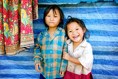 playful shy - children child thailand wpshow hmong american flag americanflag 2006 refugee phitar playful