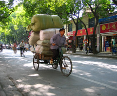 Heavy Load (Life in AsiaNZ) Tags: china street city man motion tag3 taggedout speed canon movement asia tag2 tag1 action south chinese powershot ixus southern   heavy load nanning trishaw  guangxi       mireasrealm  lifeinnanning  flickrgiants