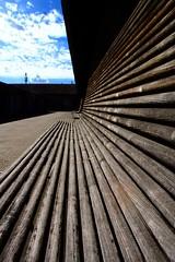 Ivan's style _ Le banc dIvan (Christine Lebrasseur) Tags: street wood blue brown france art dedication canon bench 350d dof seat perspective bordeaux depthoffield banc interestingness318 ivanroquentin allrightsreservedchristinelebrasseur