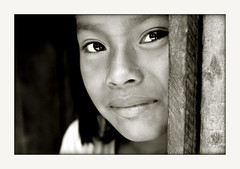 Innocent simplicity (carf) Tags: poverty girls light brazil bw white black 20d brasil paraty kids dark children hope blackwhite kid community child culture esperana social impoverished underprivileged philosophy altruism attitude identity indians names spiritual cultural indigenous guarani ethical ef50mmf14usm photophilosophy mby paratmirim bracu mundouno abigfave
