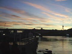 Sunset in the Calle Calle ( Valdivia Chile ) (abstraktion) Tags: sunset valdivia chile sky clouds lightintothedark light orange blue white life colors shadows silhouette peace shot people nostalgic soul happy free water metal angle humanity mirrorinthewater sun d emh ship education bridge tones
