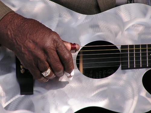 Honeyboy Edwards plays guitar