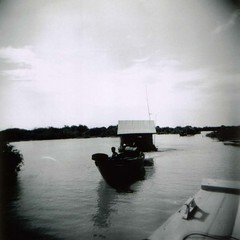mobile home (Mister Phill) Tags: bw lake delete10 delete9 delete5 delete2 boat holga cambodia delete7 delete8 delete3 delete delete4 save save2 siemreap housemove tonlesaplake vietnamesewatervillage deleet6