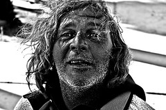 sunstroke (stoneth) Tags: poverty california ca street old portrait people blackandwhite bw 15fav white man black male eye smile face closeup drunk hair person blackwhite eyes nikon day shadows d70 nikond70 homeless poor photojournalism streetportrait forsakenpeople social impoverished 2006 1870mmf3545g human aged grayscale nikkor destitute streetshot