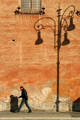 Back Light (Pensiero) Tags: street internationalexpositionplaces man rome deleteme roma building deleteme2 deleteme3 deleteme4 topf25 wall walking geotagged interestingness saveme4 saveme5 saveme6 saveme shadows savedbythedeletemegroup streetlamp saveme2 saveme3 saveme7 been1of100 saveme10 saveme8 saveme9 portfolio thewall ilmuro 80points bypensiero top20street spselection utatafeature muriromamor temadelmesegiugnoromamor fotodelmese200606romamor fotodelmeseromamor fotodelmese200606romamor19 geo:lat=41892718 geo:lon=12488354 blselect fotoleggendo2008fotocolture safedomino selexb romasel13