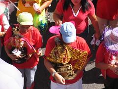 sinulog 2006 - carrying the sto. nio (adlaw) Tags: sinulog sinulog2006 procession stonino festival cebu cebucity philippines red colors tradition culture religion faith catholic cebusugbo