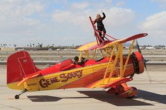 "Gene Soucy and Teresa Stokes in the Grumman Ag Cat ""Show Cat"" (Norman Graf) Tags: show cat plane airplane circus aircraft air airshow yuma wingwalking grumman showcat agcat n7699 g164 nx7699 genesoucyandteresastokes 2015yumaairshow yumaaircircus"