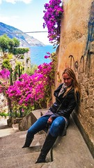 You Shall Not Pass (lost.mohican) Tags: flowers blue sea italy woman beautiful leather stone wall hair graffiti mediterranean boots terrace steps jeans jacket blonde positano stern seated