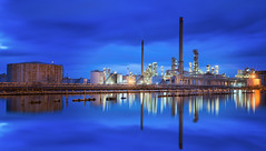 Oil refinery industry (anekphoto) Tags: oil engineering engineer petroleum boiler fuel night worker metal chemistry tower pollute pipe heavy tank liquid power pollution pipeline pollutant refinery light steam chemical technology refine automobile energy chimney sphere gas gasoline industrial manufacturing production plant petrochemical smoke sky factory boil refinement industry capacity environment auto product storage landscape