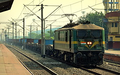 Indian Railways : Green goblin in action ! Pulls into loop for overtakes with long freight ! (Clicker Purnava) Tags: india indian railways indianrailways ir irfca iri incredible incredibleindia beauty beautiful tourist travel traveller travelling travelphotography freight train cargo goods open wagons indiatravel indialove er easternrailway eastern railway west bengal westbengal wb dkae dankuni wag9hi wag9 clw loco locomotive rail rails track road railroad cloudy cloudyday day mps afternoon consist iron sheets ironsheets steel brna flatbed headlamp headlight devil goblin secr trainsworldwide worldtrains railfan railfanning trainspotters trainspotting ferroequinologist trainwatchers sport electric awesome winter vehicle outdoor