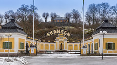 Skansen-Eingang (Entry) (wuestenigel) Tags: tierpark animals tiere 2017 zoo winter skansen schweden pets svenska sweden stockholm wildetiere skansenentry touristattraction nationalpark stockholmslän se architecture diearchitektur building gebäude travel reise house haus noperson outdoors drausen traditional traditionell old alt street strase sky himmel religion city stadt entrance eingang tourism tourismus exterior äusere culture kultur town family familie tree baum door von