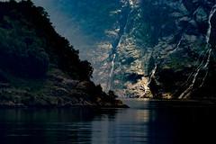 Heading for the light (e-box 65) Tags: geiranger geirangerfjord fjord light mountains norway romsdal sea berg norwegen dark dunkel licht journey ship marak water