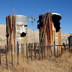 Ha-Ha-Ha... Oh Man, That's Funny, Tell Me Another! (nedlugr) Tags: california ca watertanks carrizoplain carrizoplainnationalmonument nationalmonument usa ruraldecay rust ruralwest rural fence hills sanluisobispocounty tumbleweeds dry dryasdust windmill laugh face ladders