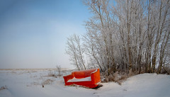 Time to Relax (VanveenJF) Tags: red fujifilm winter holiday couch bench outside cold snow bush alberta edmonton stalbert xt10 samyang 12mm wideangle season field garbage refuse old recycle
