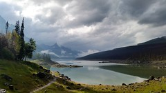 Shedding Some Light on Mysterious Medicine Lake (Patricia Henschen) Tags: medicine lake medicinelake jaspernationalpark canada parkscanada parks parcs clouds mountains moody sunlight sliver reflections reflection boreal forest canadian rockies northern rocky alberta pathscaminhos