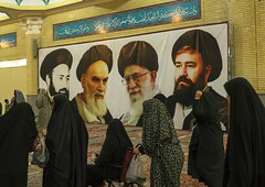 Pilgrims Going In Front Of The Ayatollah Khomeini Mausoleum, Shemiranat County, Behesht-e Zahra, Iran (Eric Lafforgue) Tags: travel portrait signs history sign horizontal poster beard dead photography death mural memorial paint iran propaganda painted muslim islam religion visit icon billboard womenonly indoors memory hero posters billboards leader iranian revolutionary groupofpeople adultsonly heroic pilgrim islamic imam shiite placeofworship ayatollah qom glorification commemorate ghom famousplace khomeini glorify   beheshtezahra 5people colourimage qum  iro shiiteislam  nonwesternscript  shemiranatcounty iran150897