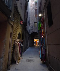 Barcelona street with manniquins (ashabot) Tags: barcelona city travel spain mannequins medieval catalunya streetscenes alleys lightanddark seetheworld medievalstreet medievalstreets worldcities