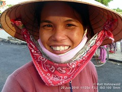 2013-10a Facing the Asian Conical Hat (03) (Matt Hahnewald) Tags: portrait smiling ethnic posing street character eyes matthahnewaldphotography face facingtheworld hoian horizontal head nonla hat vietnam vietnamese strawhat conical sedgehat diversity panasoniclumixdmctz11 ricepaddyhat expression headshot lifestyle 1200x900pixels resized colour people 4x3ratio closeup consensual lookingatcamera