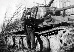 A crew member of the 3rd SS panzer division Totenkopf stands next to his panzer v: panther tank (Date and location unknown)