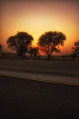 Sunset Colors (AQAS) Tags: sunset light colors trees moterway pakistan countryside dusk orange