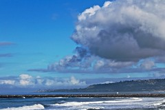 Cloudy Day at Mission Bay Jetty to Pacific Beach from OB Pier (iseedre) Tags: clouds ocean jetty waves rocks riprap pacificbeach