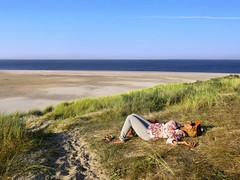 Kanitha relaxing at the Northern tip of Texel island (B℮n) Tags: texel natuur noorderhaaks de hors mokbaai militaire activiteiten mens en milieu kustbescherming stuifdijken oefenterreinen verstoring vervuiling nature dunes dehors formation birds air rush grass terns summer hiking wandelaar duinvorming sand noord holland nederland thehors texelisland southernpointoftexel beachplain 2kmplain coastalplain unrealscenery sandbeach walkonthemoon walkinthedesert completelost mokbay waddenzee desolatelandscape desolaat relax enjoy beach strand vuurtorel lighthouse cocksdorp relaxiing sunbathing zonnen blue sky sea