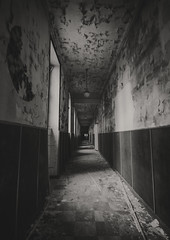 The Darkness (Martyn.Smith.) Tags: corridor passageway dark creepy urbex decay abandoned school passage hall bw mono darkness decaying abandonment france canon eos flickr image photo niksilverefex shadows