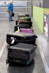 On the go -- luggage carousel (diffuse) Tags: 117 luggage baggage bags carousel waiting watching airport arrival