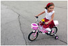 Happy - Rovinj, Croatia (TravelsWithDan) Tags: candid streetphotography girl bike trainingwheels pink happy riding child rovinj croatia canon5d outdoors city pavement