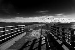 Down the path through darkness and light. (shadowsoul) Tags: blackandwhite blackandwhitephotography shadowsandlight monochrome skyline outdoor sea lines pier