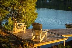 A Muskoka chair morning (John Prior 55) Tags: muskokachairs chairs docks morningsun cottagecountry lakes water otterlake parrysound ontario