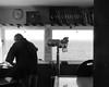 (Kelvin P. Coleman) Tags: canon powershot landsend coast shore sea water street candid people work volunteer watchkeeper lookout binoculars files folders radar clock window frame backlit backlight contrejour blackandwhite monochrome bw noiretblanc schwarzweiss blancoynegro indoor