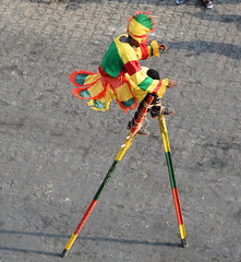 COLORFUL STILT DANCER,  TOGO (vermillion$baby) Tags: africa dancer fun green lome people red togo wharf yellow color colora pier