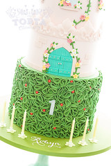 Nieces 1st Birthday Cake (tortacouturecakes) Tags: birthday pink green tower castle cake ruffles ticino vines purple ganache first massa fondant crenelations