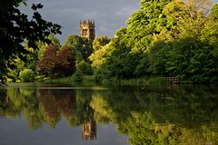 St Mary's Church, Lymm (Chris Beesley) Tags: trees sunset summer sun lake reflection green church water cheshire lymm lymmdam