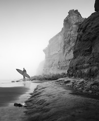 san diego : torrey pines surfer (William Dunigan) Tags: san diego torrey pines state park reserve fog morning cliff beach ocean sea surfer early black white photography sepia toned southern california