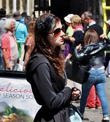 Canterbury High Street - June 2015 - Dark & Mysterious Girl Candid Portrait (gareth1953 Cataract Creating Chaos) Tags: street portrait woman black flower girl beautiful sunglasses kent candid young posing canterbury front mature mysterious sunlit darkhaired fascinator