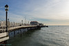 Worthing pier (1862) (Rourkeor) Tags: worthing england unitedkingdom gb pier lamps sea wooden structure amusements seaside water reflections people flags sony sonyrx1r rx1r fullframe carlzeiss zeiss sonnar t 35mm