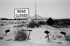 What Road? (greenschist) Tags: cinestillbwxx shadows usa santanvalley zeissikonzm film blackwhite arizona sign zeissbiogon35mmf20tzm analog mountain
