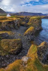 The white house at the cliffs (Sander Grefte) Tags: iceland ijsland landscape landschap house huis cliffs sea zee rotsen rots rocks sandergreftephotoscom shore seashore