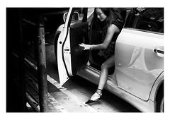 the arrival (handheld-films) Tags: hongkong street girl woman car reportage monochrome blackandwhite asia arrive arrival