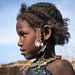 Side view of an Issa tribe child girl with traditional hairstyle, Afar region, Yangudi Rassa National Park, Ethiopia