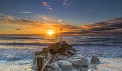 Sunrise Splash (nicklucas2) Tags: mudeford sun sunrise solent wave sea pebble needles lighthouse isleofwight avonbeach groyne seaside