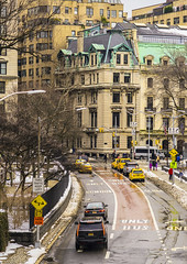 """Road Exit from """"Central Park (""""Winter Season 2016-2017 In NYC"""") (nrhodesphotos(the_eye_of_the_moment)) Tags: dsc0423172 """"theeyeofthemoment21gmailcom"""" """"wwwflickrcomphotostheeyeofthemoment"""" winterseason20162017innyc winter season manhattan nyc centralpark transportation architecture eastside building taxis cars roadway signs streetlights reflections shadows windows glass metal rooftops trees snow fence marble publicart sculpture"""