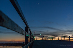 First Ocean Drive sunset of 2017 (artseejodee) Tags: newjersey stoneharbornj downtheshore oceandrive jerseyshore capemay capemaycounty northwildwood lines view outside project365 icw street sun night nature sky sunset moon ocean drive stoneharbor aquarius crescent crescentmoon railing bridge orange blue happynewyear skyporn jersey shore nj road travel go green light color colourful